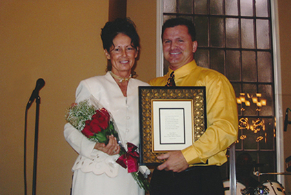 Vickie and Terry accepting Minister of Music Award Image